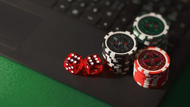 Poker Chips and Dices on a Green Table